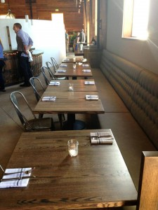 Tables at the recently opened West End Tap & Kitchen at Westside Santa Cruz's Swift Street Courtyard