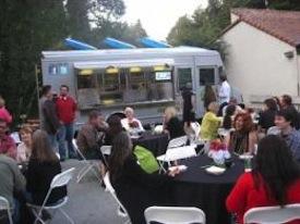 Attendees at First Friday Santa Cruz enjoying dinner from a food truck