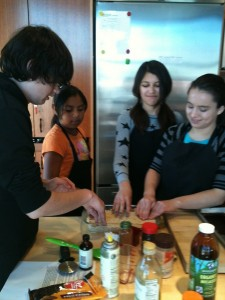 Participants making treats at a Halloween class for teens led by Lauren Hoover-West