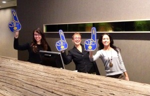 Hotel Paradox staff showing their Warriors love with foam fingers