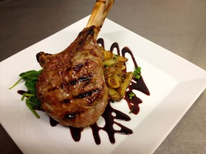 An example of the food at Monterey's Cibo Restaurant: Costoletta di Vitello Ariana (All Natural Veal Chop, Roasted Yukon Potatoes, Wilted Spinach, Red Wine & Pomegranate Reduction)