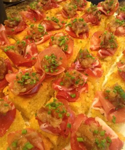Andrea Mollenauer's signature rosemary polenta cake with onion jam and prosciutto