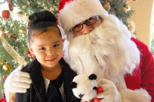 "Santa Claus and a breakfast guest at last year's ""Breakfast with Santa"" at Chaminade"