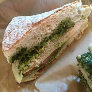 The signature Panino Tutto Fresco with turkey roasted in-house plus homemade pesto, provolone and tomato
