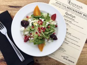 Baby Beet Salad with pomegranate seeds and goat feta crumbles is one of Chaminade's appetizers for Santa Cruz Restaurant Week 2016