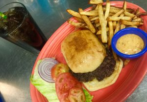 Hula's is offering a discount burger combo during its anniversary month Photo credit: Hula's